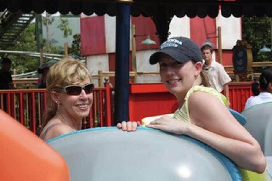 Now: Rhonda Empfield and Natalie Empfield Halladay at Magic Kingdom in Orlando, Florida on the Dumbo ride, 2013. Photo: Courtesy Photo / Rhonda Empfield