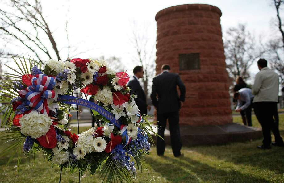 Family members surround a cairn dedicated to those who died on Pan Am Flight 103 during a ceremony at Arlington National Cemetery in Virginia. Photo: Getty Images / 2013 Getty Images