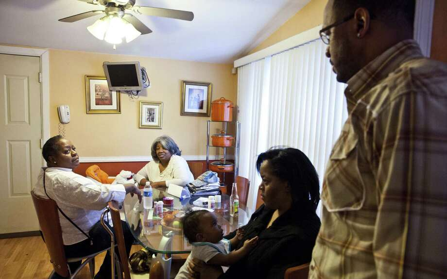 Relatives of Jesse Webster  gather at home in Chicago. Webster, who turned himself in when he learned the police were searching for him, is among an estimated 2,000 federal inmates serving life without parole for nonviolent offenses. Photo: Nathan Weber / New York Times / NYTNS