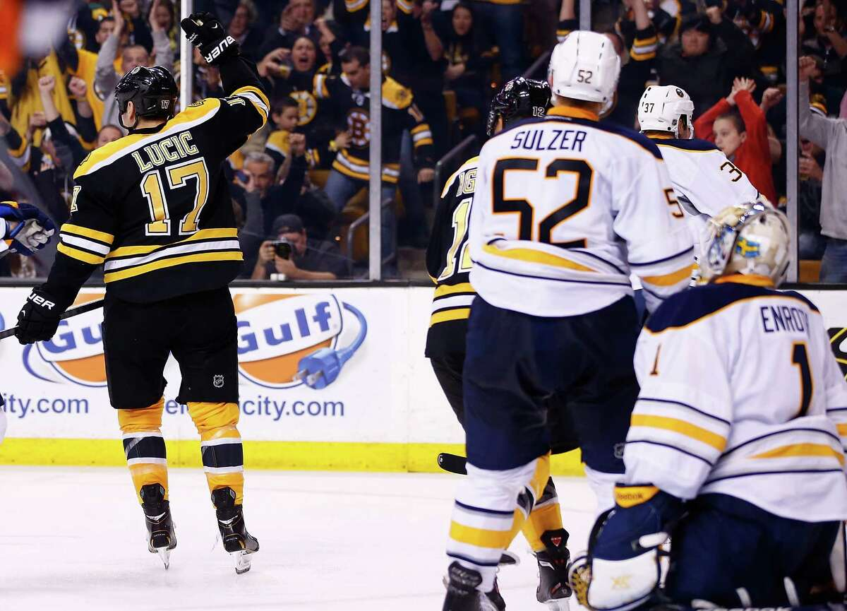 BOSTON, MA - DECEMBER 21: Milan Lucic #17 of the Boston Bruins celebrates his goal in the third period against the Buffalo Sabres during the game at TD Garden on December 21, 2013 in Boston, Massachusetts. (Photo by Jared Wickerham/Getty Images) ORG XMIT: 181112307
