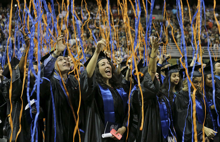 University of Texas at San Antonio graduate Manal Foty (center) and others celebrate in a shower of ribbons during their ceremony in the Alamodome. Photo: Edward A. Ornelas / San Antonio Express-News / © 2013 San Antonio Express-News