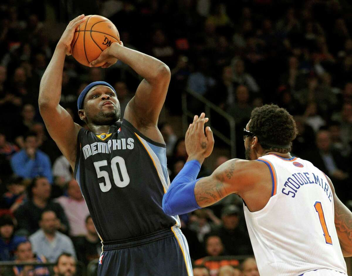 Memphis Grizzlies' Zach Randolph (50) goes up for a shot over New York Knicks' Amar'e Stoudemire during the third quarter of an NBA basketball game Saturday, Dec. 21, 2013, at Madison Square Garden in New York. The Grizzlies defeated the Knicks 95-87. (AP Photo/Bill Kostroun) ORG XMIT: NYBK104