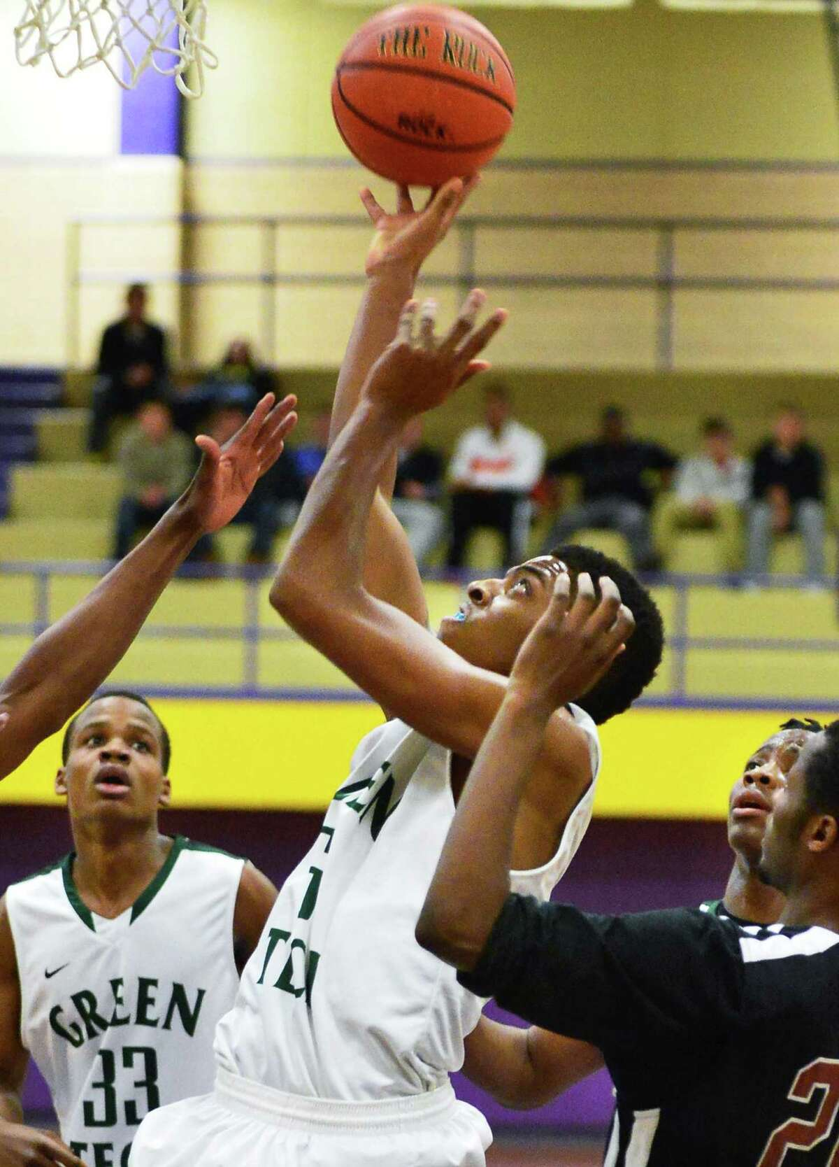 Green Tech's #3 Isiah Dobhere shoots during Saturdays game against Kingston at Troy High Dec. 21, 2013, in Troy, NY. (John Carl D'Annibale / Times Union)
