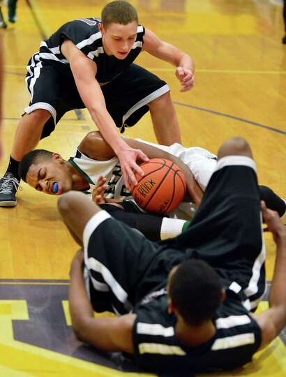 Kingston's #11 Cole Jordan, top, and #32, Anthony Gaines, at bottom, range with Green Tech's #5 Davi