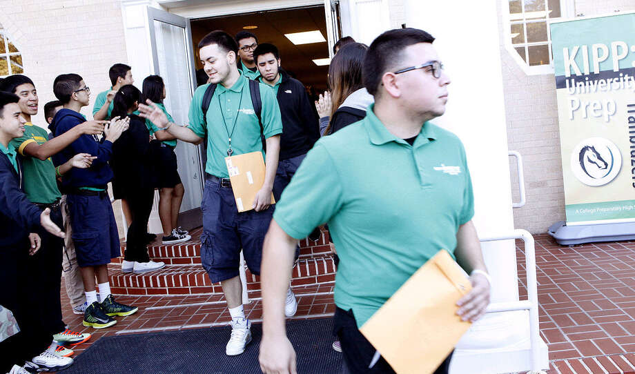 KIPP University Prep High seniors head out to mail college applications. Local KIPP schools exceeded state standards. Photo: Cynthia Esparza / For The San Antonio Express-News / San Antonio Express-News