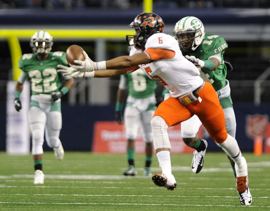 Aledo's John Whatley makes a 34-yard catch in front of Brenham's Courtland Sutton in the first half. The catch started the Bearcats' third drive and helped set up a field goal for a 3-0 lead. Photo: Matt Strasen /Associated Press / FR170476 AP