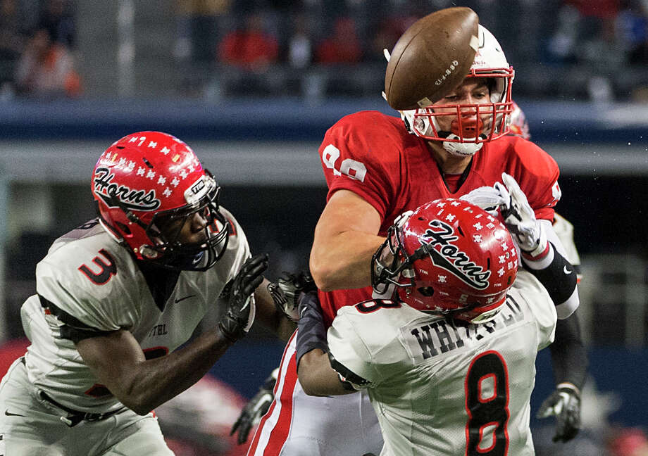Katy's Sloan Spiller (88) was unable to hang on to a second-half pass after taking a big hit from a pair of Cedar Hill defenders. Photo: Smiley N. Pool, Staff / © 2013  Houston Chronicle
