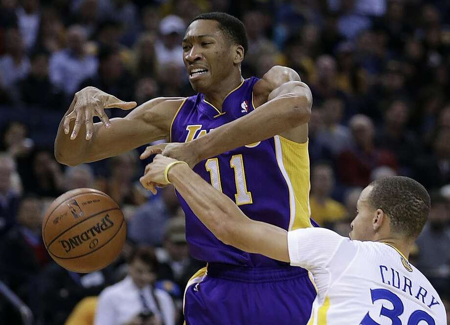 Stephen Curry picks Wesley Johnson's pocket in the first half, when the game remained tight throughout. Neither team handled the ball well, nor shot well. Photo: Ben Margot, Associated Press