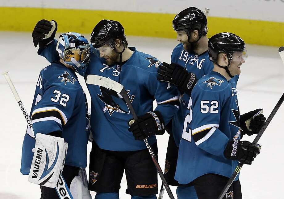 Sharks goalie Alex Stalock celebrates with teammates Brad Stuart (7), Joe Thornton (19) and Matt Irwin after the victory. Photo: Marcio Jose Sanchez, Associated Press
