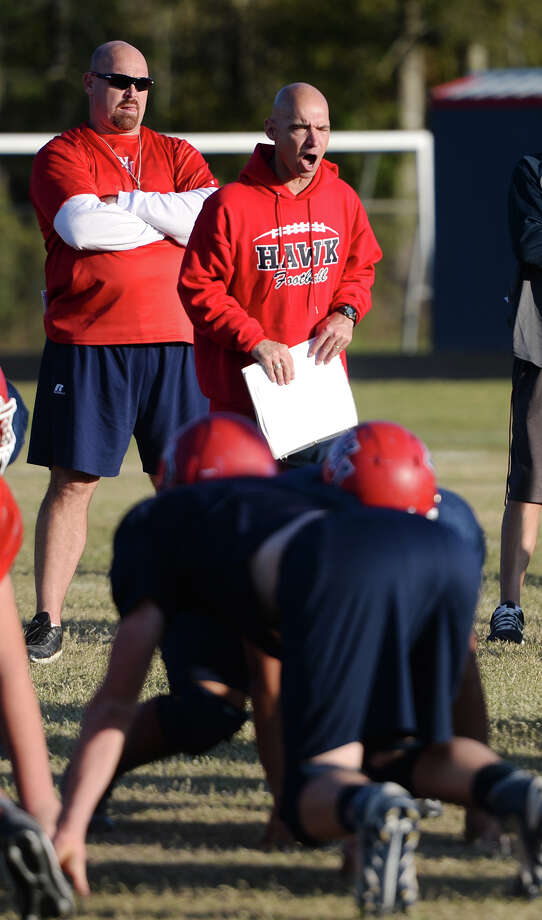 Coach Dwayne Dubois corrects players positions during practice at Hardin-Jefferson High School on Wednesday afternoon.  Photo taken Jake Daniels/@JakeD_in_SETX Photo: Jake Daniels / ©2013 The Beaumont Enterprise/Jake Daniels