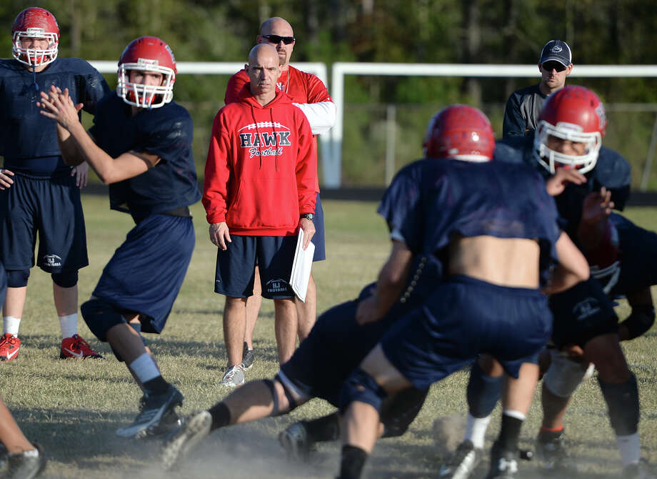 Coach Dwayne Dubois watches the offense run through a play during practice at Hardin-Jefferson High School on Wednesday afternoon.  Photo taken Jake Daniels/@JakeD_in_SETX Photo: Jake Daniels / ©2013 The Beaumont Enterprise/Jake Daniels