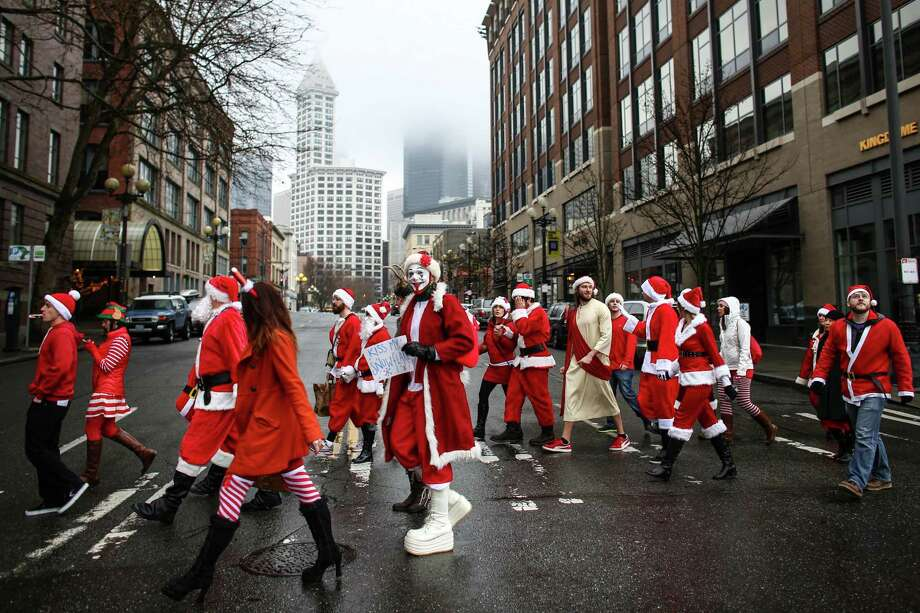 A pack of Santas walk to a bar in Pioneer Square. Photo: JOSHUA TRUJILLO, SEATTLEPI.COM / SEATTLEPI.COM