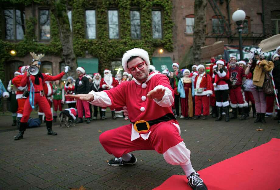 Santa practices his twerking in Occidental Park. Photo: JOSHUA TRUJILLO, SEATTLEPI.COM / SEATTLEPI.COM