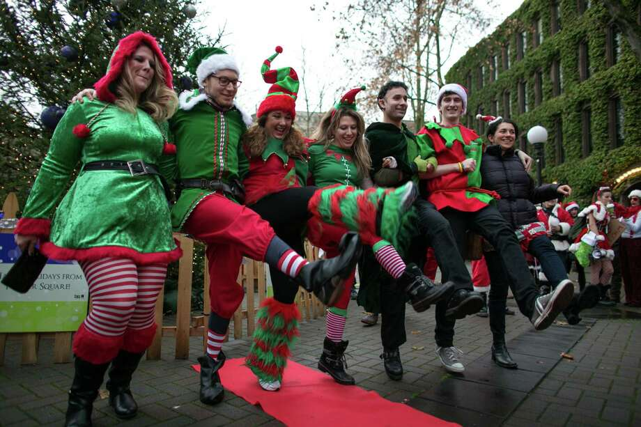 Elves get in on the action during a fashion show in Occidental Park. Photo: JOSHUA TRUJILLO, SEATTLEPI.COM / SEATTLEPI.COM
