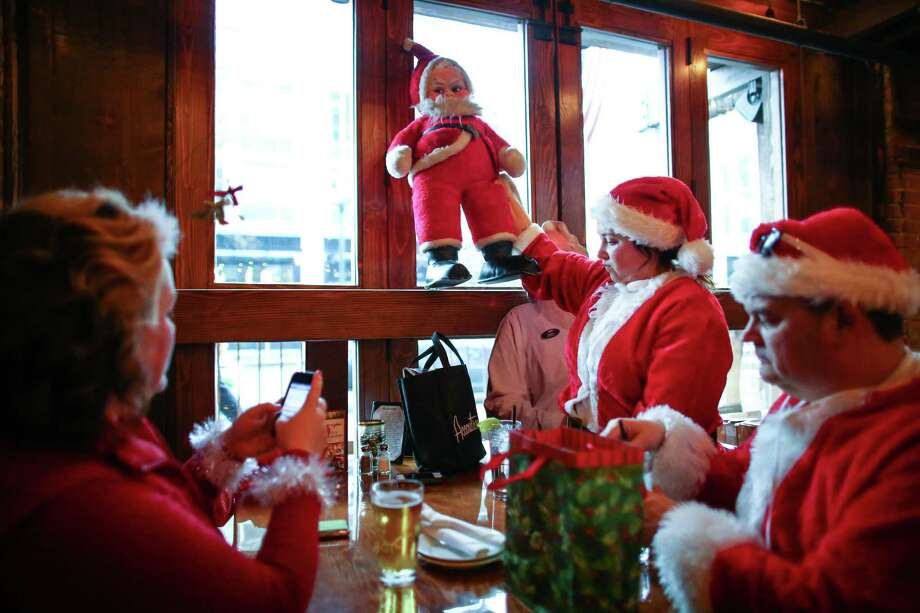 A grumpy Santa is placed on a shelf in The Lodge Sports Grille. Photo: JOSHUA TRUJILLO, SEATTLEPI.COM / SEATTLEPI.COM