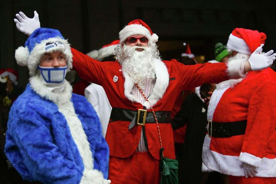 Santas of all shades gather at the King Street Station. Photo: JOSHUA TRUJILLO, SEATTLEPI.COM / SEATTLEPI.COM
