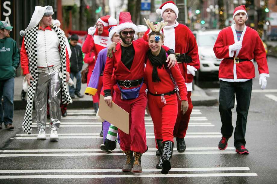 Participants march to the next destination. Photo: JOSHUA TRUJILLO, SEATTLEPI.COM / SEATTLEPI.COM