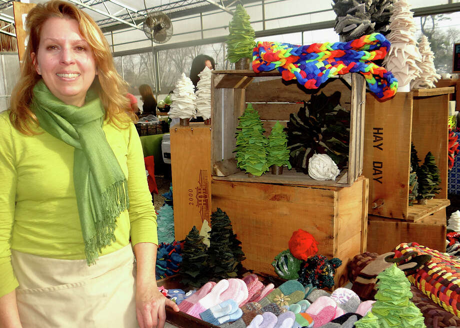 Condie Ward with holiday decor made from recycled sweaters and t-shirts Saturday at the Westport Winter Farmers Market. Photo: Mike Lauterborn / Westport News contributed