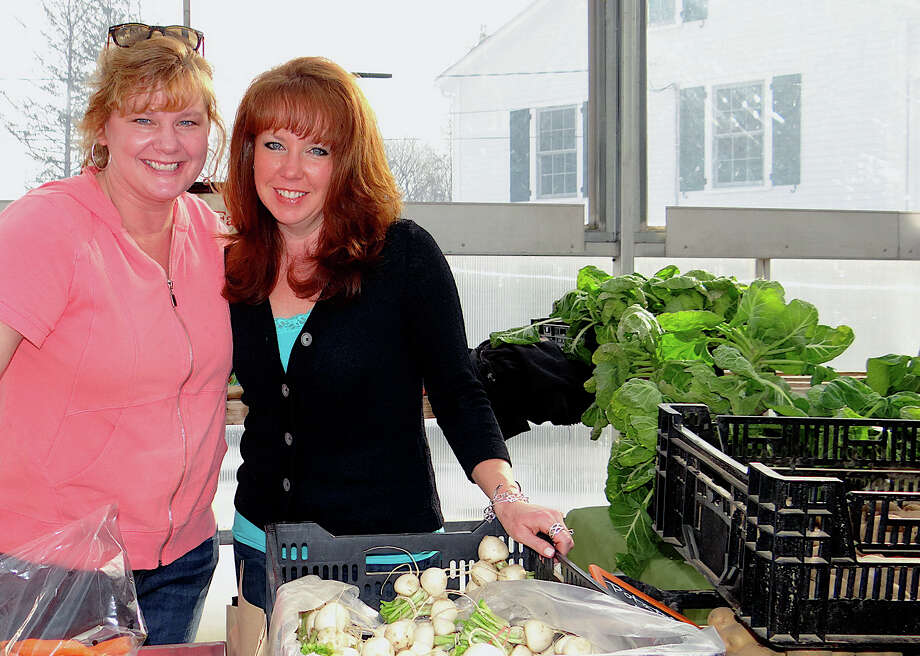 With fare from Sport Hill Farm in Easton were Patti Popp and Elizabeth Beller at the Westport Winter Farmers Market. Photo: Mike Lauterborn / Westport News contributed