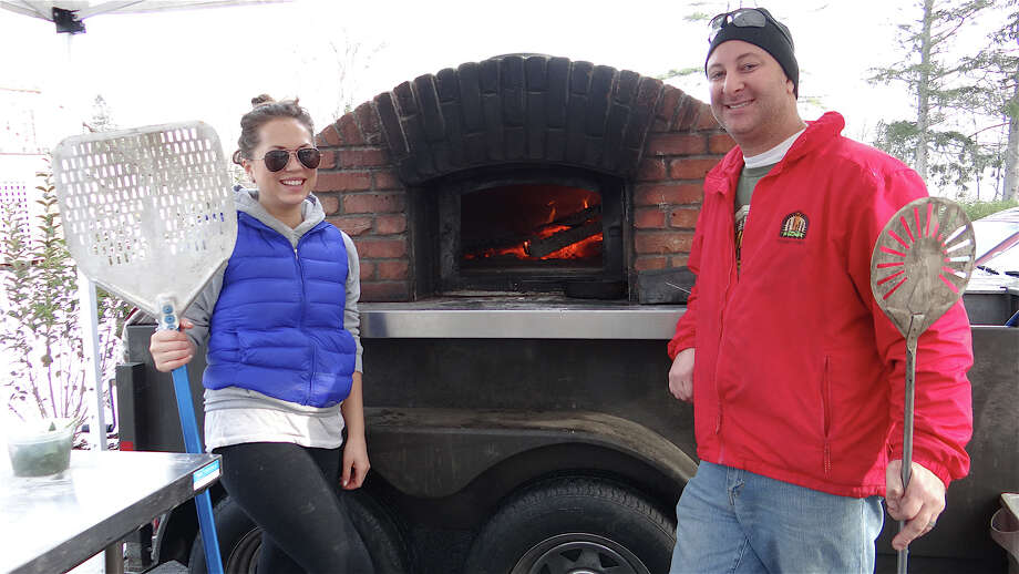 Skinny Pines Pizza's Amy Franquet and Victor Malindretos at the Westport Winter Farmers Market on Saturday. Photo: Mike Lauterborn / Westport News contributed