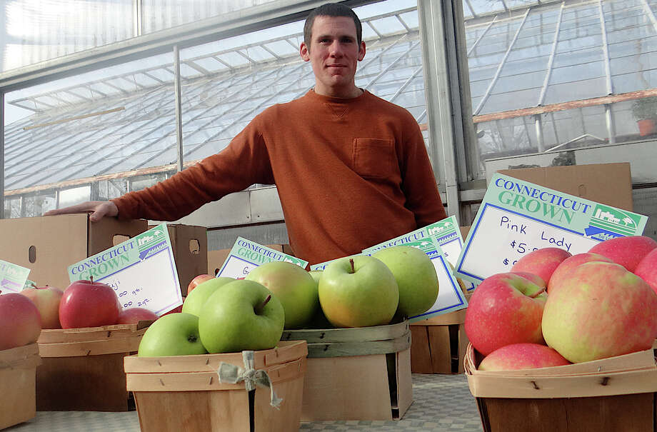 Shane Teveris of Woodland Farm in South Glastonbury offered state-grown apples at the Westport Winter Farmers Market. Photo: Mike Lauterborn / Westport News contributed