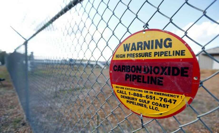 In this Oct. 22, 2013, photo, one of several warning signs line the secured at Denbury Resources Inc.'s, Tinsley Field facility in Tinsley, Miss. Photo: Rogelio V. Solis / Associated Press