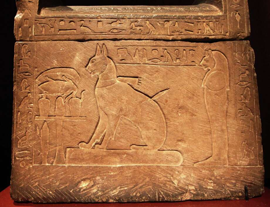 This Wednesday, May 23, 2012 file photo shows the sarcophagus for Prince Thutmose's cat at an exhibit in Seattle. Thutmose lived during the 18th dynasty of Egypt which ruled from around 1500 BC to 1300 BC. The earliest evidence of domestic cats is found in Egyptian artwork from about 4,000 years ago. But a wild cat was buried with a human on Cyprus 9,500 years ago, indicating some kind of close relationship existed then. Between those two points, experts say, the story of cat domestication is murky. Photo: Elaine Thompson, AP / AP2012