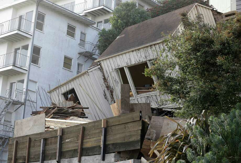 A construction crew works on a house that collapsed late Monday in San Francisco, Tuesday, Dec. 17, 2013. Authorities say a house under construction has collapsed in the hilly San Francisco neighborhood of Twin Peaks. KTVU-TV reports there are no reports of injuries following the collapse late Monday night. Photo: Jeff Chiu, AP / AP