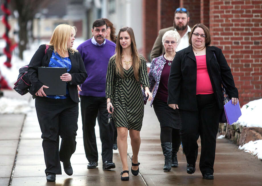 Troy LaFerrara's family arrive at the Northumberland County courthouse for the preliminary hearings of Miranda and Elyette Barbour, Friday, Dec. 20, 2013, in Sunbury, Pa. Miranda and Elytte Barbour, newlyweds who police said wanted to kill someone together were ordered Friday to stand trial on charges they lured a stranger with a Craigslist ad, stabbed him to death after he got into their car and dumped his body in an alley. (AP Photo/PennLive.com, Christine Baker) Photo: Christine Baker, AP / Christine Baker | cbaker@pennlive.com