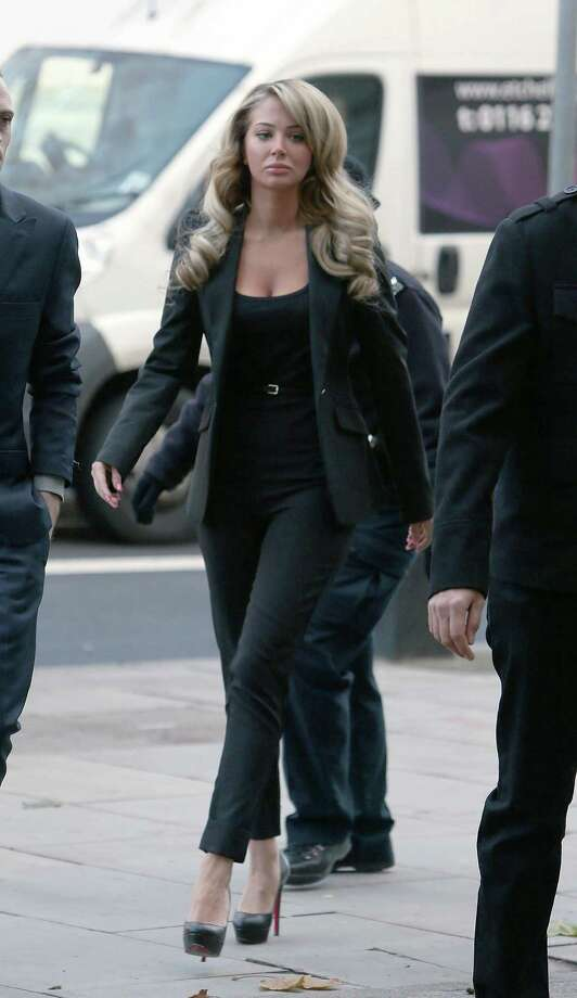 Tulisa Contostavlos arrives at Westminster Magistrates Court in central London where she will appear charged in connection with the supply of Class A drugs, London, Thursday, Dec. 19, 2013. (AP Photo/PA, Steve Parsons)  Photo: Steve Parsons, AP / AP2013