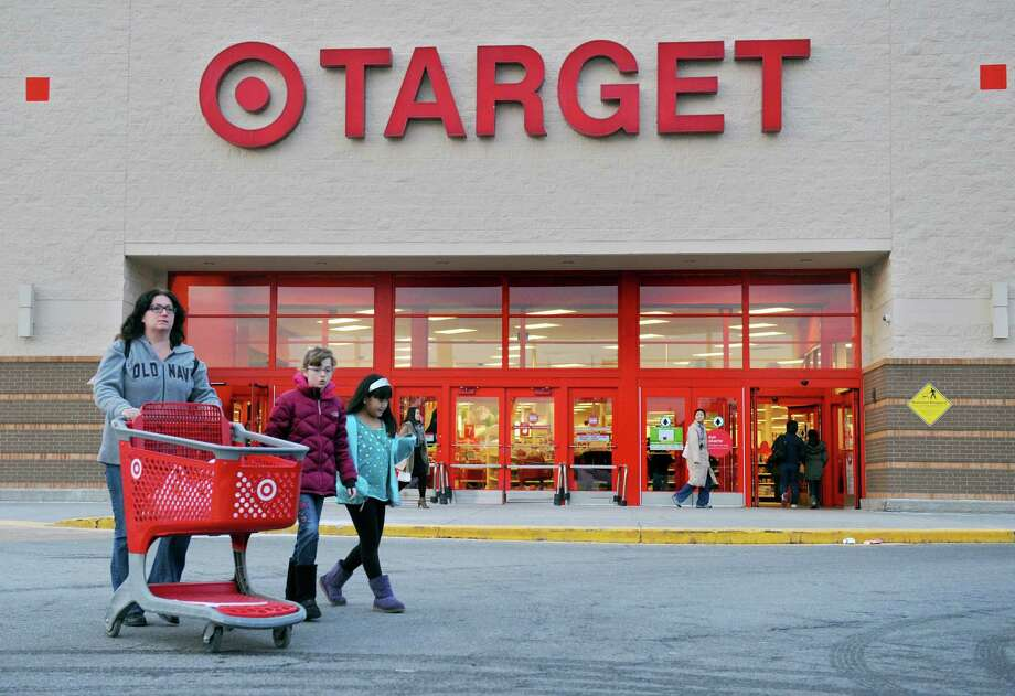 Shoppers leave a Target this week in Hackensack, N.J. Target says about 40 million credit and debit card customers may have been affected by a data breach that occurred between Nov. 27 and Dec. 15. Photo: Amy Newman, MBR / Northjersey.com