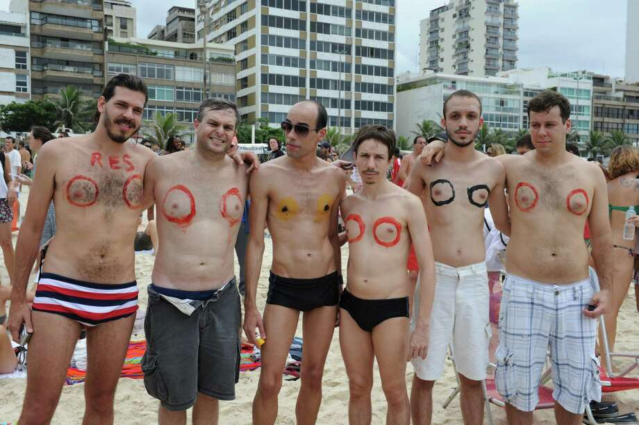 Men take part in a demonstration on December 21, 2013 at Ipanema beach in Rio de Janeiro, Brazil to protest against the criminalization of topless by women. AFP PHOTO/TASSO MARCELO Photo: TASSO MARCELO, Getty Images / 2013 AFP