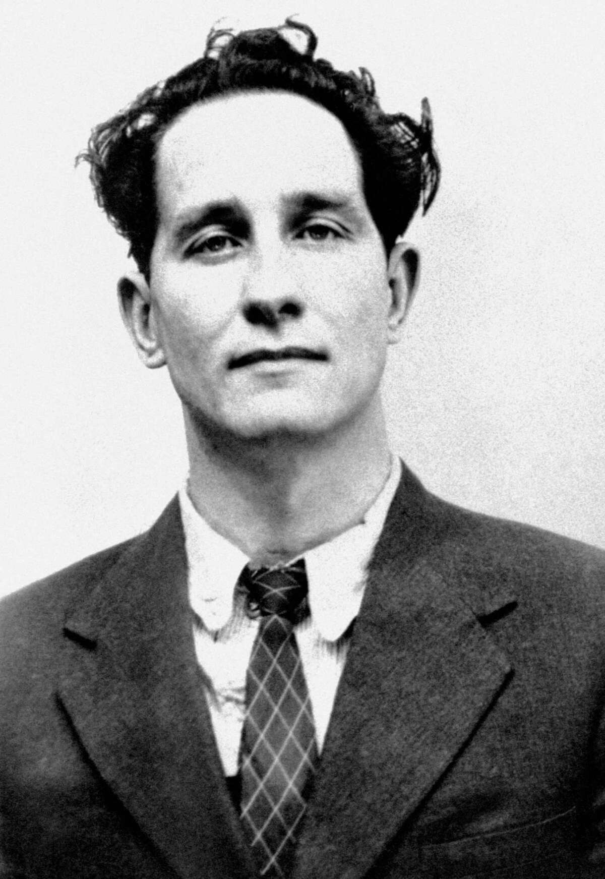 Ronnie Biggs, known for his role in the 1963 Great Train Robbery, died Wednesday, Dec. 18, 2013, his daughter-in-law said. He was 84. Photo is of Biggs in July 8, 1963 (AP Photo/PA, File)