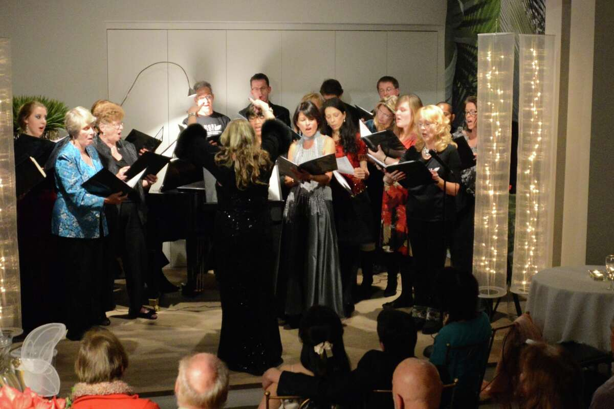 Pamela Kuhn conducts the Angel Choir.