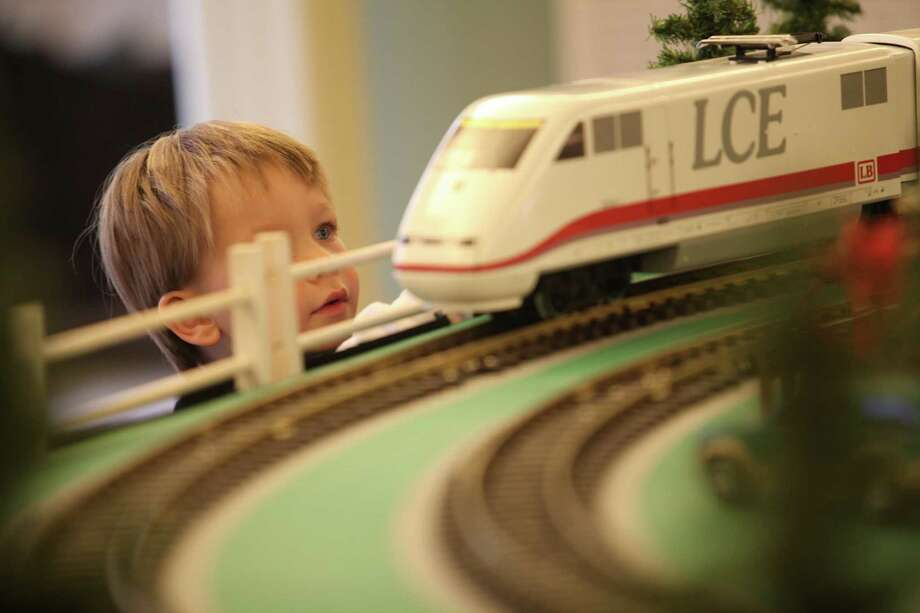 Ethan Silen-Kuehn, 2, watches the trains at the Fairfield Museum & History Center on Sunday, Dec.22, 2013. Ethan has visited the show five times already; the Holiday Express Train Show  runs through Jan. 5, 2014. Photo: BK Angeletti, B.K. Angeletti / Connecticut Post freelance B.K. Angeletti