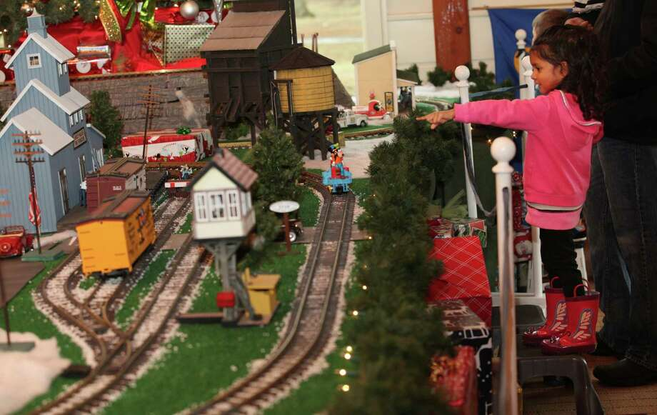 Kiran Rajan, 3,  watches the trains at the Fairfield Museum & History Center on Sunday, Dec.22, 2013. The Holiday Express Train Show  runs through Jan. 5, 2014. Photo: BK Angeletti, B.K. Angeletti / Connecticut Post freelance B.K. Angeletti