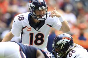Broncos quarterback Peyton Manning prepares to take a snap against the Texans.