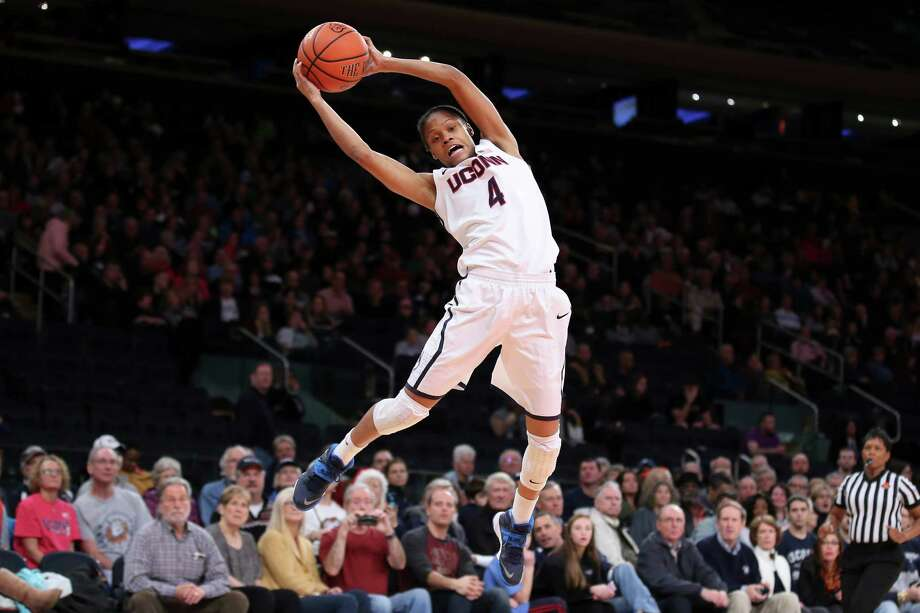 Connecticut guard Moriah Jefferson (4) catches a wild pass during the second half of an NCAA college basketball game against California as part of the Maggie Dixon Basketball Classic at Madison Square Garden, Sunday, Dec. 22, 2013, in New York. Connecticut defeated California 80-47. Photo: John Minchillo, AP / Associated Press