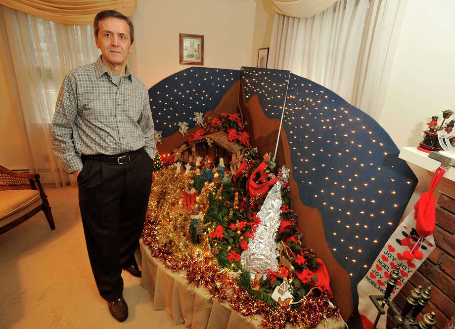 Diego Musilli poses next to the Christmas nativity he built in his home in Stamford, Conn., on Sunday, Dec. 22, 2013. This is Diego's 35th consecutive year he has created the model for his family. Photo: Jason Rearick / Stamford Advocate