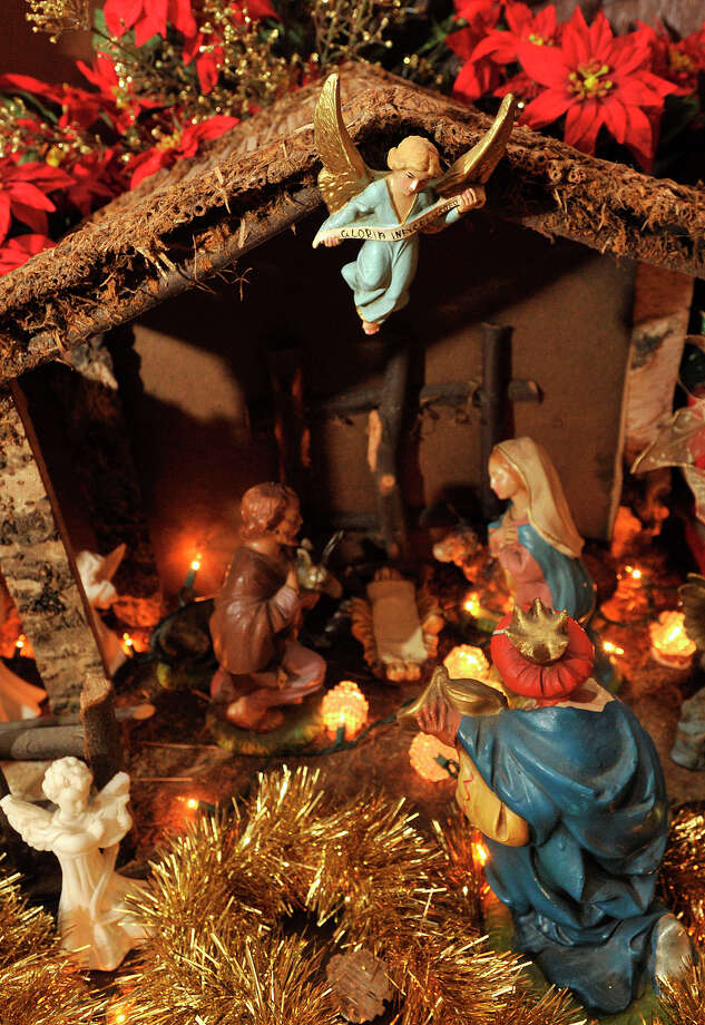 A figurine of a an angel hovers over a Christmas nativity displayed in Diego Musilli's home in Stamford, Conn., on Sunday, Dec. 22, 2013. This is Diego's 35th consecutive year he has created the model for his family. Photo: Jason Rearick / Stamford Advocate