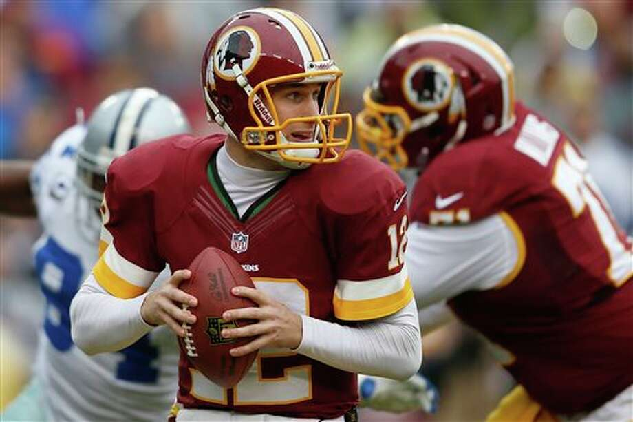 Washington Redskins quarterback Kirk Cousins looks for an opening to pass during the first half of an NFL football game against the Dallas Cowboys in Landover, Md., Sunday, Dec. 22, 2013. Photo: Evan Vucci, AP / AP