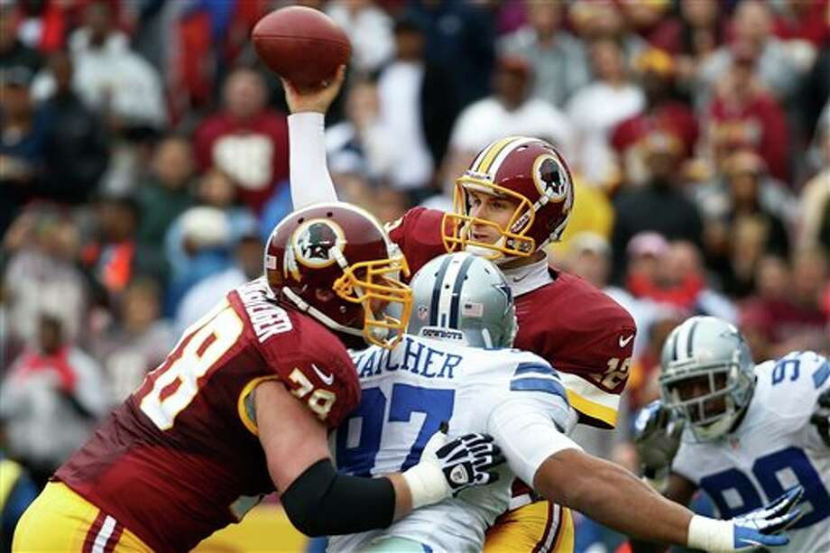 Washington Redskins quarterback Kirk Cousins passes the ball during the first half of an NFL football game against the Dallas Cowboys in Landover, Md., Sunday, Dec. 22, 2013. Photo: Alex Brandon, AP / AP