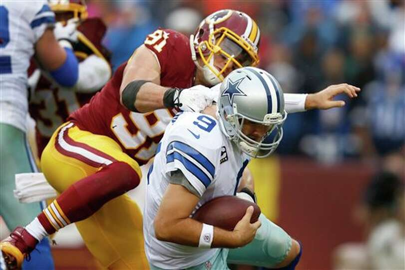 Dallas Cowboys quarterback Tony Romo is sacked by Washington Redskins outside linebacker Ryan Kerrig