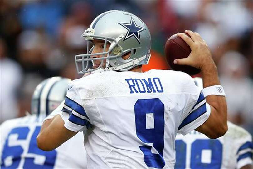 Dallas Cowboys quarterback Tony Romo looks for an opening to pass during the second half of an NF