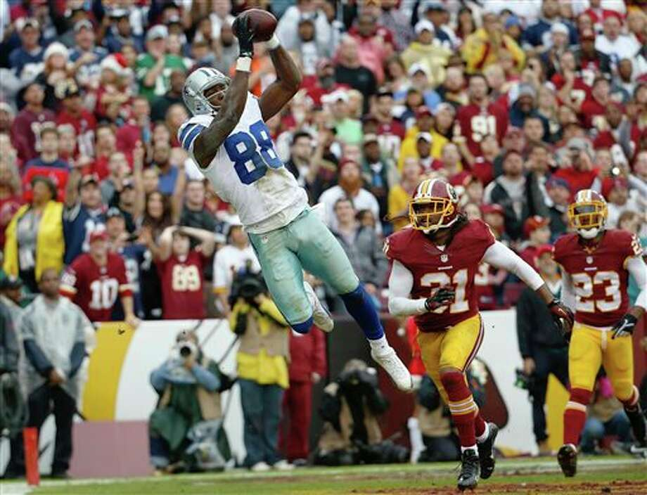 Dallas Cowboys wide receiver Dez Bryant pulls in a touchdown pass next to Washington Redskins strong safety Brandon Meriweather during the first half of an NFL football game in Landover, Md., Sunday, Dec. 22, 2013. Photo: Alex Brandon, AP / AP
