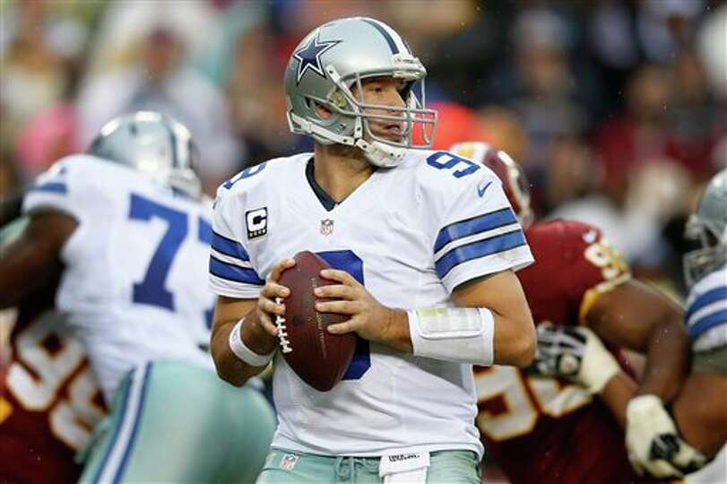 Dallas Cowboys quarterback Tony Romo looks for an opening to pass during the second half of an NFL f