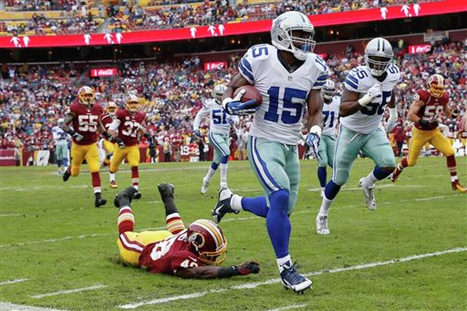 Dallas Cowboys wide receiver Micheal Spurlock (15) leaves Washington Redskins strong safety Jose Gumbs on the turf while returning a punt during the first half of an NFL football game in Landover, Md., Sunday, Dec. 22, 2013. Photo: Alex Brandon, AP / AP