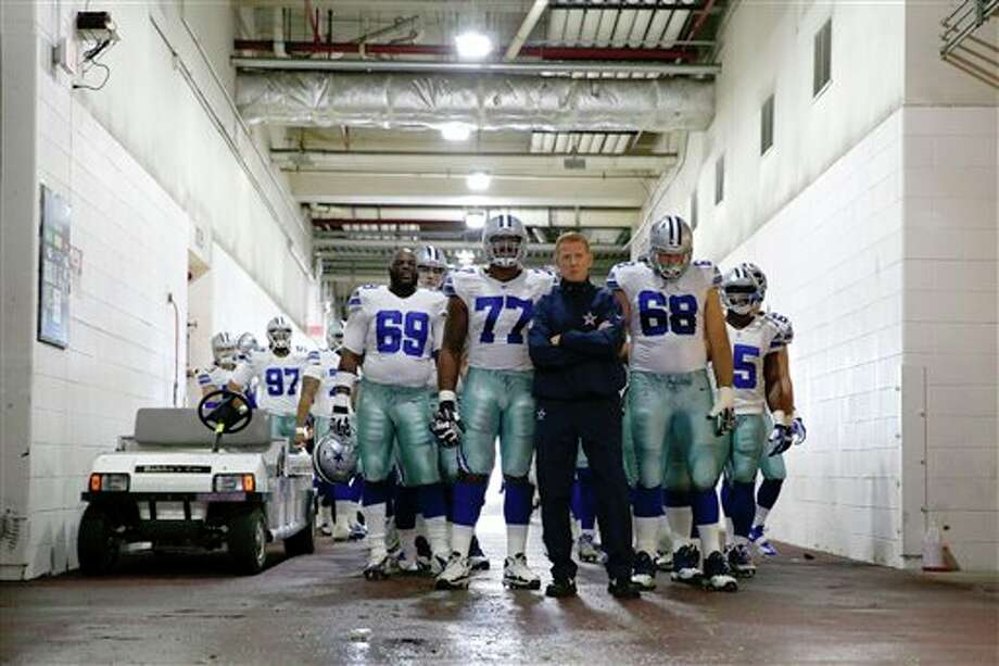Dallas Cowboys head coach Jason Garrett stands with the team in the tunnel as they wait to be introduced before an NFL football game against the Washington Redskins in Landover, Md., Sunday, Dec. 22, 2013. Photo: Alex Brandon, AP / AP