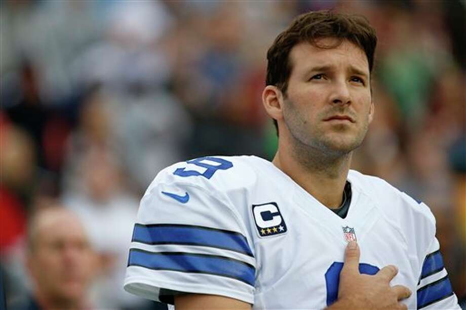 Dallas Cowboys quarterback Tony Romo stands on the sidelines during the National Anthem before an NFL football game against the Washington Redskins in Landover, Md., Sunday, Dec. 22, 2013. Photo: Alex Brandon, AP / AP