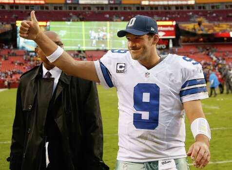 Dallas Cowboys quarterback Tony Romo flashes a thumbs-up as he walks off the field after the Cowboys defeated the Washington Redsksins 24-23 in an NFL football game in Landover, Md., Sunday, Dec. 22, 2013. (AP Photo/Evan Vucci) Photo: Evan Vucci, Associated Press / AP